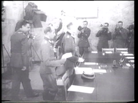 Germany surrenders to the Allied powers in a Reims France schoolhouse