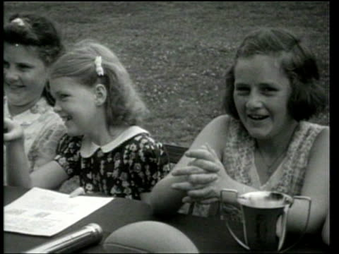 """universal newsreel. girls conduct a contest to determine a """"freckles"""" king. - 1939 stock-videos und b-roll-filmmaterial"""