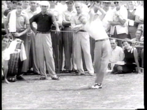 golf professional ben hogan competes with 15 year old amateur dean beaman at leesburg virginia - ニュース映画点の映像素材/bロール