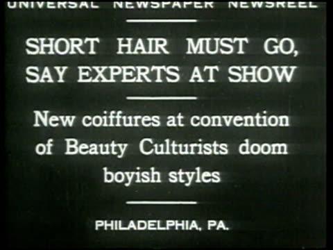 stockvideo's en b-roll-footage met hair models display longer hairstyles at a hairstyle convention in philadelphia - haaraccessoires