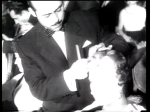 hairdressers compete in a hairdressers guild competition in lisbon - newsreel stock videos & royalty-free footage
