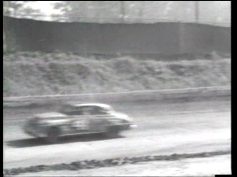 herb thomas smiles after he wins an accidentmarred race on a dirt track at atlanta georgia - ニュース映画点の映像素材/bロール
