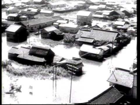homeowners wade or use rafts as they salvage what they can to recover from the typhoon that hit japan - newsreel stock videos & royalty-free footage