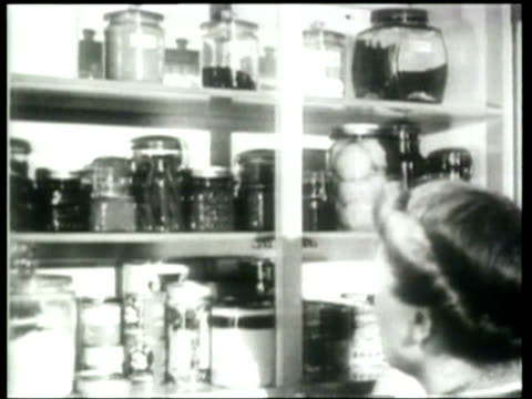 how we lived as merchants and homemakers adjust their food to accommodate war requirements a government official explains the color coded stamp system - food stamps stock videos & royalty-free footage
