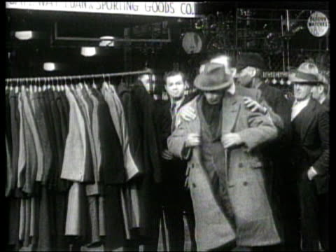 merchants donate clothes and outerwear to jobless men - great depression stock videos & royalty-free footage