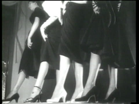 models display new fall fashions in hosiery for women - newsreel stock videos & royalty-free footage