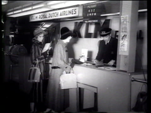 models display the latest handbag fashions as they depart for europe - newsreel stock videos & royalty-free footage