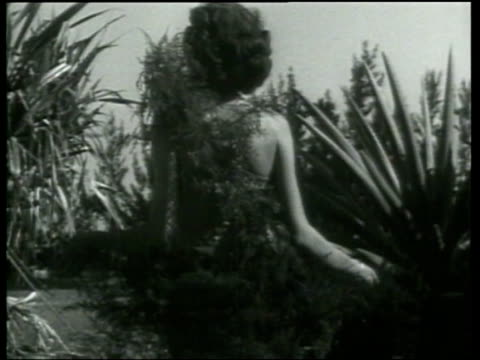 models wear novel bathing suits made of flowers - newsreel stock videos & royalty-free footage