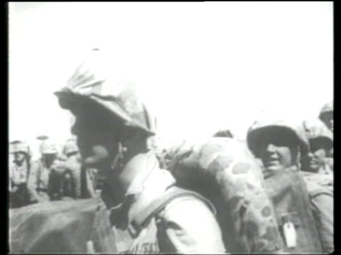 newly recruited us navy and marine corps troops mobilize for warfare in the korean conflict soldiers fight with artillery casualties are buried - korean war stock videos & royalty-free footage