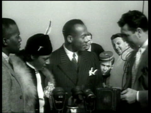 Olympic champion Jesse Owens is interviewed as he returns to the United States