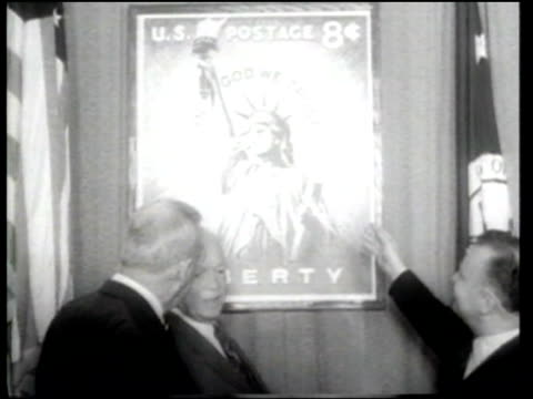 postmaster general arthur summerfield presents president eisenhower with a new range of stamps to celebrate liberty and faith in america - ニュース映画点の映像素材/bロール