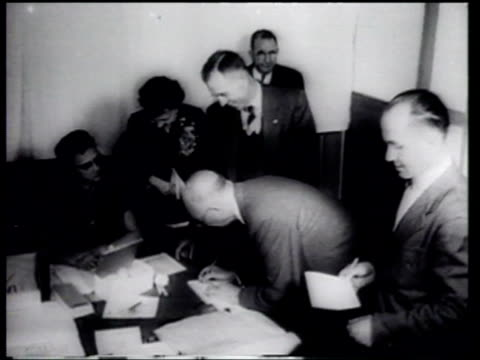 president dwight eisenhower and opponent adlai stevenson vote in their home precincts president eisenhower is reelected - ニュース映画点の映像素材/bロール