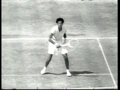 Queen Elizabeth II congratulates Althea Gibson for her tennis championship at Wimbledon