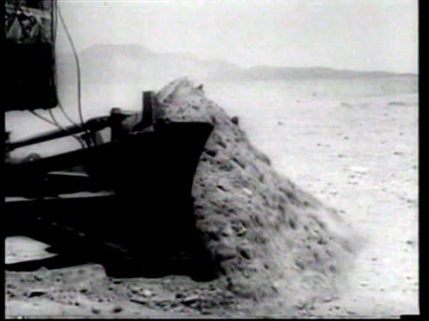 radiation shielded bulldozers are tested at a nuclear test site in the nevada desert. - 1957 stock-videos und b-roll-filmmaterial