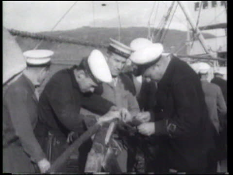 shipboard technicians complete the first transatlantic telephone cable - atlantik stock-videos und b-roll-filmmaterial