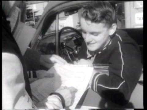 sixteen year old mark marshall wins a 106 mile automobile economy competition in northern california - ニュース映画点の映像素材/bロール