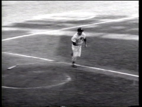 the new york yankees defeat the brooklyn dodgers 95 at yankee stadium in game one of the world series - ニュース映画点の映像素材/bロール
