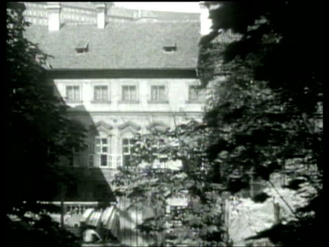 the staff at the american legation in prague construct a bomb shelter in the garden area. - newsreel stock videos & royalty-free footage