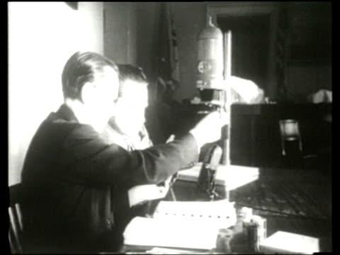us congressman richard nixon and an attorney review microfilm found on whitaker chambers maryland farm - richard nixon stock-videos und b-roll-filmmaterial