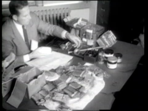 us federal agents make a sizeable drugs bust - newsreel stock videos & royalty-free footage