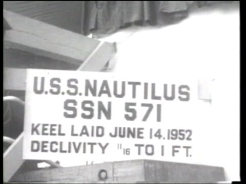 US First Lady Mamie Eisenhower and Commander Eugene P Wilkinson christen and launch USS Nautilus an atomicpowered submarine