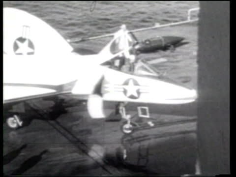 us navy commander james f verdin tests the navy's new f4d skyray delta wing jet fighter as he makes a takeoff and landing on cv43 in the uss coral sea - newsreel stock videos & royalty-free footage