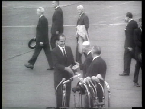 us president dwight eisenhower receives a warm reception from konrad adenauer at the bonn airport - 1959 stock-videos und b-roll-filmmaterial