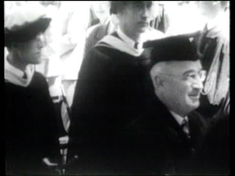 vídeos de stock, filmes e b-roll de us president harry truman speaks at princeton university to an audience including famous graduates on the need for universal training to prevent war - albert einstein
