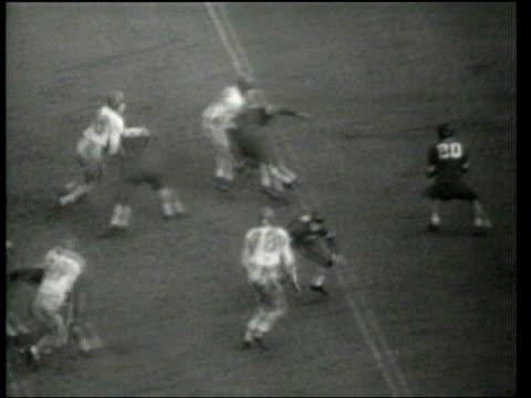 defeats duke 7-3 in the 1939 rose bowl. - 1939 stock-videos und b-roll-filmmaterial