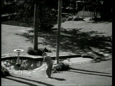 fields demonstrates lazy golf. - 1939 stock-videos und b-roll-filmmaterial