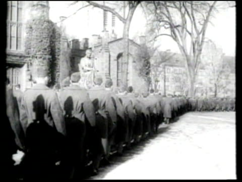 while army air corps cadets train at yale, coeds train and condition in the snow. - エール大学点の映像素材/bロール