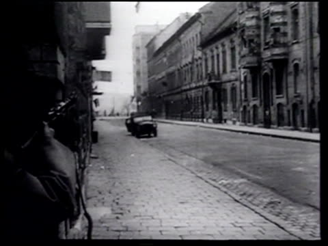 stockvideo's en b-roll-footage met some hungarians fight others flee as soviet troops use armor and other weapons to quell an uprising - 1956