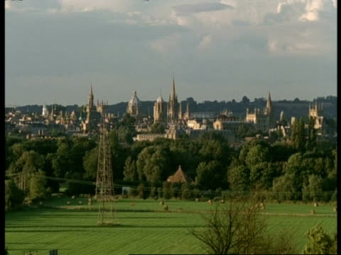 university buildings & city of oxford - st clement from south park, wa high angle view of spires & domes, greenery & pylon in foreground - oxford university stock videos and b-roll footage