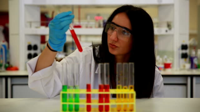 university chemistry laboratory research student - laboratory flask stock videos & royalty-free footage