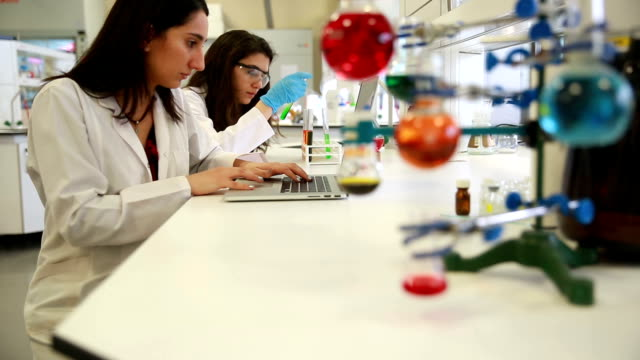 University Chemistry Laboratory Research Students Working in Class Together