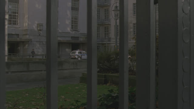 university college london senate bldg.; pan w/ military vehicle r-l, then tilt up - senate stock videos & royalty-free footage