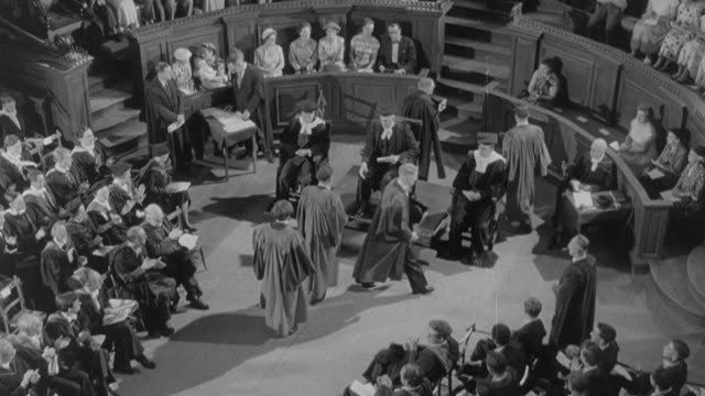 1960 montage university graduation ceremony / united kingdom - graduation stock videos & royalty-free footage