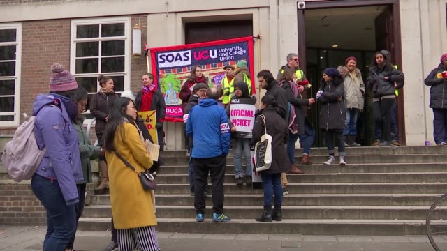 University lecturers strike over proposed changes to pensions ENGLAND London SOAS EXT Various shots of striking workers on picket line outside SOAS...