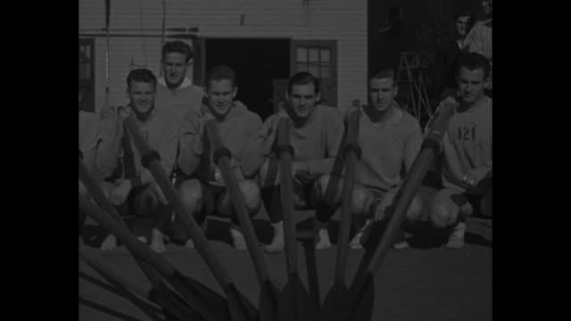 university of california 8 golden bears oarsmen pose for photo with oars / large group of oarsmen run with oars / oarsmen in water / coach ky ebright... - university of california stock videos and b-roll footage