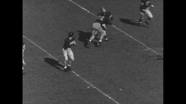 University of California Berkeley Golden Bears quarterback Bill Mais #22 passes to Hal Ellis #81 in end zone for a touchdown during football game...