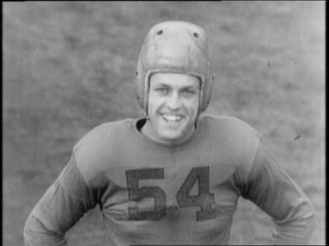 University of California sign / Bob Reinhard walks with books in hand / Reinhard in uniform puts on a football helmet / starting from a three point...