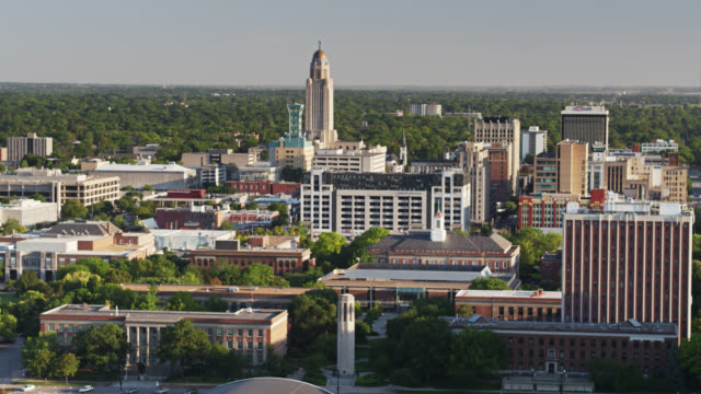 university of nebraska in lincoln with state capitol beyond - aerial - nebraska stock videos & royalty-free footage