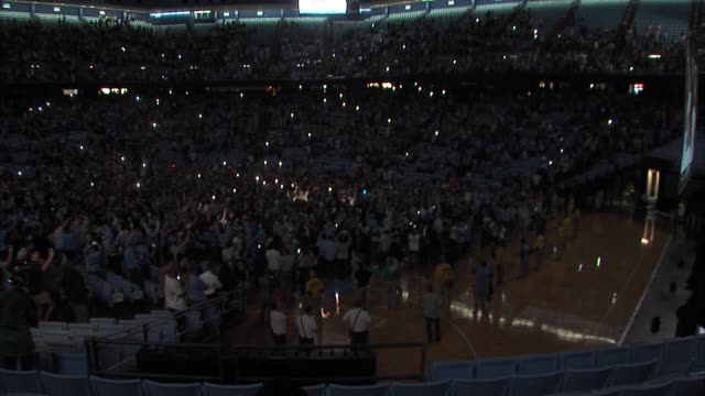 WGHP University of North Carolina men's basketball fans celebrate the team winning the NCAA Championship Game on April 3 2017 from a watch party at...