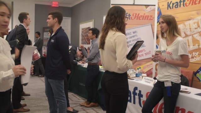 university of pennsylvania students speak with job recruiters at a career fair in at the sheraton hotel in university city, philadelphia, pa, sept.... - 就職フェア点の映像素材/bロール