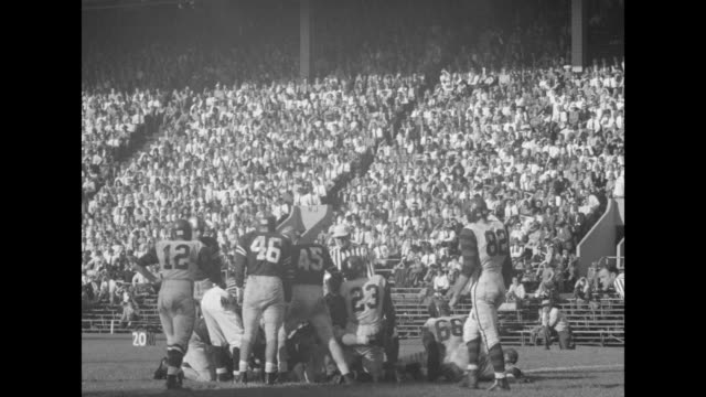 University of Pennsylvania/Dartmouth College football game various plays and one touchdown / fans bring down the goalposts /Note exact year not known...