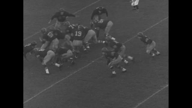 university of southern california's frank gifford #16 makes jump in attempt to gain yardage in football game against university of california... - jump ball stock videos and b-roll footage