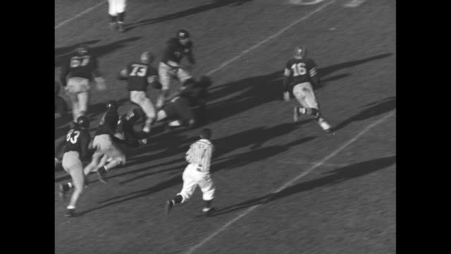 university of southern california's frank gifford #16 runs and passes ball to quarterback dean schneider #19 who scores touchdown in game against... - university of california stock videos & royalty-free footage