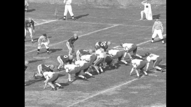 university of virginia cavaliers and duke university blue devils football teams run onto field at scott stadium for game / duke quarterback worth... - shirt and tie stock videos & royalty-free footage
