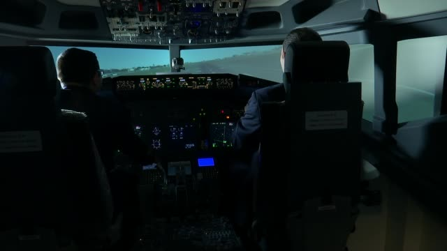 university of west london giving people chance to use flight simulator in bid to encourage more people to join industry university of west london... - cockpit stock videos & royalty-free footage