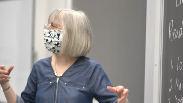 university professor wearing a mask while teaching - fatcamera stock videos & royalty-free footage